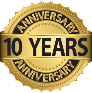 Gold badge with black text that says 10 years anniversary.