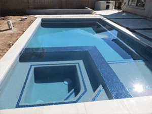 Almost completed swimming pool, still in the building phase.