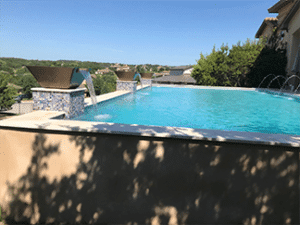 Elegant swimming pool, crystal clear water, swimming pool has fountain water features.