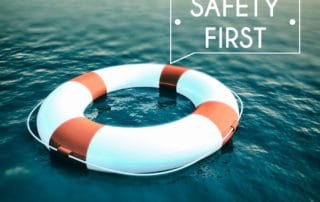 Life float in the water and text says safety first