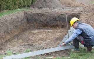 Contractor starting the process of building a swimming pool.