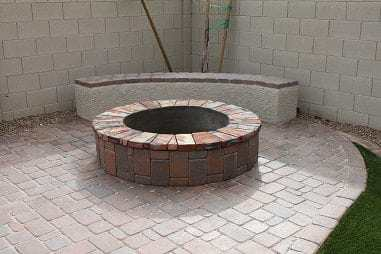 Close up of a fire pit with a sitting area behind it. Located in Mesa, Arizona.