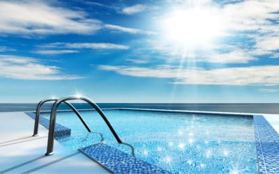 Sun beaming down a swimming pool. The water is radiant from the sunshine.