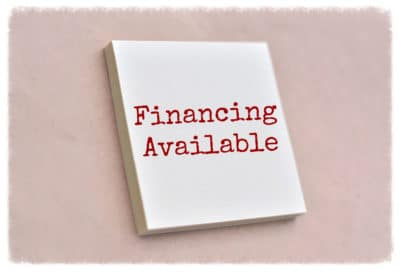 Text financing available on the sticky note texture background.