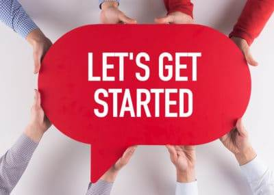Red conversation box with white text that says Let's Get Started. Support people have their hands touching the conversation bubble.