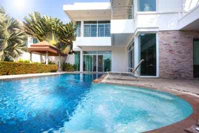 real estate Interior and exterior design of pool villa which features living area, greenery garden, pavilion and swimming pool.