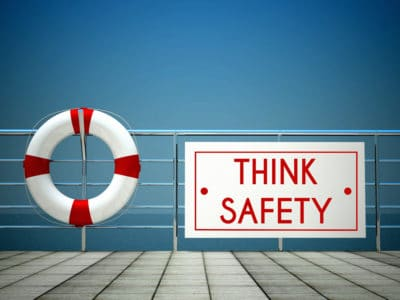 Think Safety sign at the swimming pool with lifebuoy.