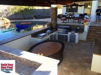 Inside of the Glendale, Arizona gazebo, showing the fire pit and outdoor cooking area. The gazebo has a view of the swimming pool and the patio area.