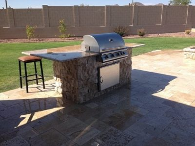 White family grilling station in backyard.