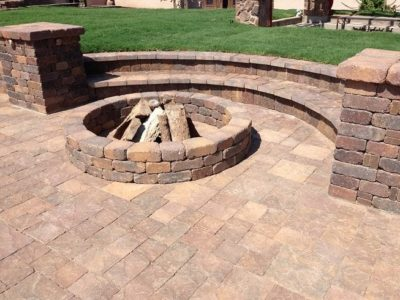 Brick sitting area with a brick, built in fire pit in the center. Located in Mesa, Arizona.
