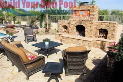 Gorgeous backyard space in Tucson, Arizona that has a swimming pool, fire bowls, hot tub, and a huge brick fire place surrounded by chairs to lounge in.