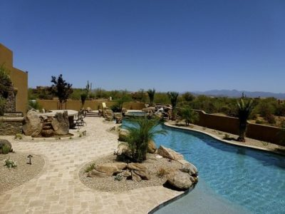 Day time view of the swimming pool and hot tub in the Dill family's backyard.
