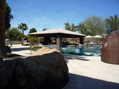 Gorgeous swimming pool connected to a huge gazebo area that has a lounge area. Located in Phoenix, Arizona.