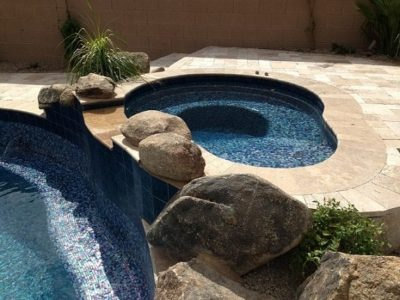 Close up of a spa deck next to a swimming pool.