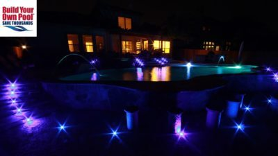 Fort Worth, Texas pool with ground lights all around the swimming pool and down the stairs, beautiful, lit up backyard.