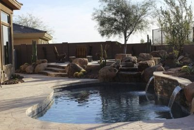 Jackson family backyard swimming pool located in Phoenix, Arizona. Shows two small water falls flowing into the pool.
