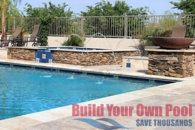 Family located in Chandler, Arizona showing their backyard swimming pool with a hot tub and huge fire bowl next to it. Swimming pool has three special water features.