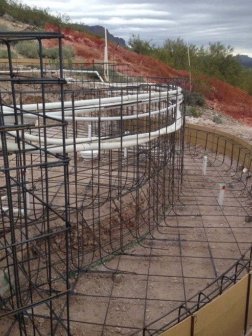 Close look on the side of a swimming pool in Mesa, Arizona that is being built with the help of BYOP. Here you can see the swimming pool has had pool rebar added.