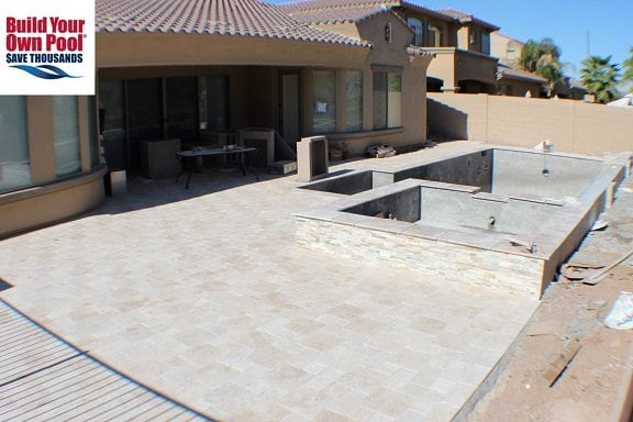 Pool patio surface surrounding a swimming pool that is being built for a family in El Paso, Texas.