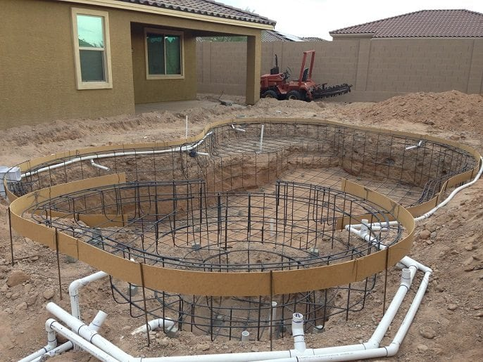 This photo gives you a view of the next step in the process of building a pool. This photo shows the process of framing pool steel, adding pool rebar.
