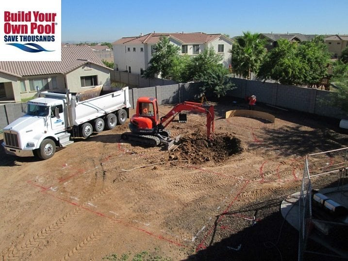 A homeowner in Austin, Texas who has decided to build a swimming pool. There is a white truck and an orange bulldoze in the backyard. The photo is an overhead view of the swimming pool layout and shows the start of the excavation process.