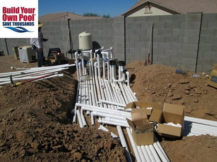Close up view of a swimming pool being built in Phoenix, Arizona. You are able to see all of the equipment for the pool plumbing process.