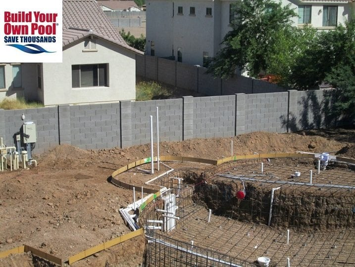 Close up view of a backyard in Phoenix, Arizona. The backyard is in the process of having a swimming pool built. The pool plumbing has begun.