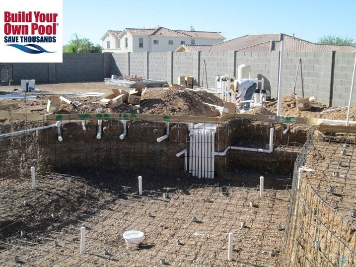Close up view of a swimming pool construction process. The swimming pool has been lined with pool rebar.