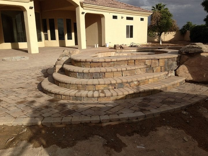 Installing tile around a newly built swimming pool in Tucson, ArizonacA view of an extravagant new swimming pool and patio surface that has been built with the help of BYOP. A view of an extravagant new swimming pool and patio surface that has been built with the help of BYOP.