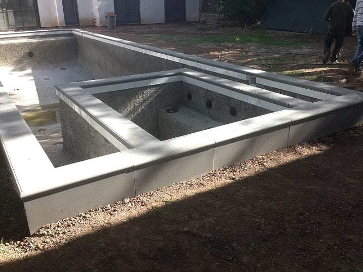 A view of a new swimming pool that has been built in Chandler, Arizona. The next step will be to work on the patio surface.