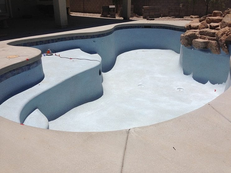 Photo shows a swimming pool finish for a swimming pool that has been built in Phoenix, Arizona.