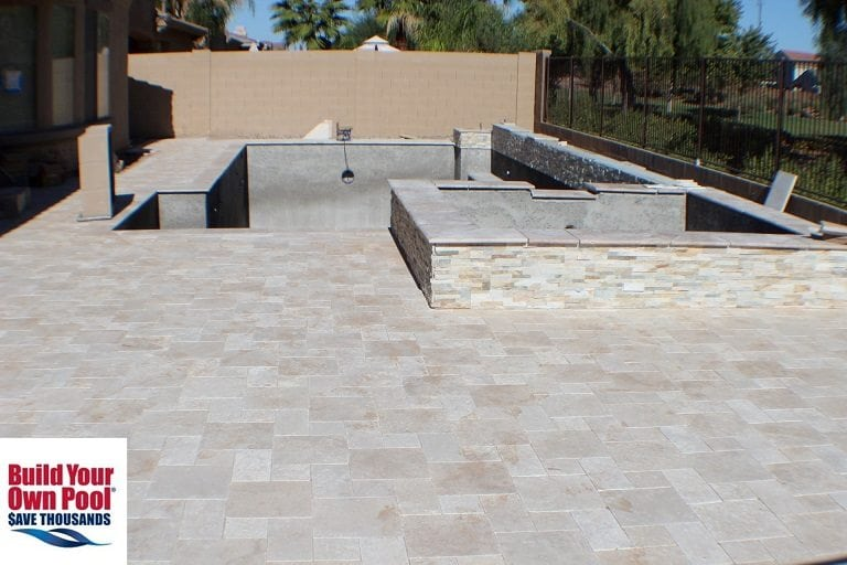 A zoomed out view, looking primarily at the pool decking surface.