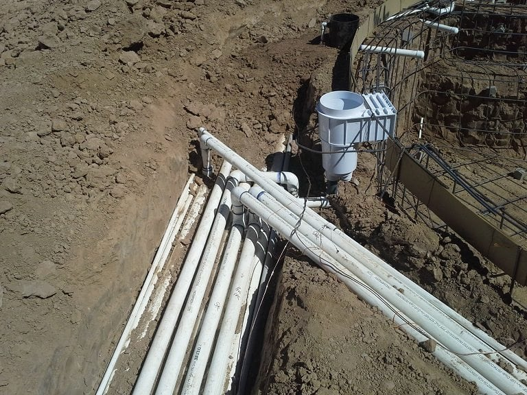 Close up view of swimming pool pipes for the pool plumbing system.