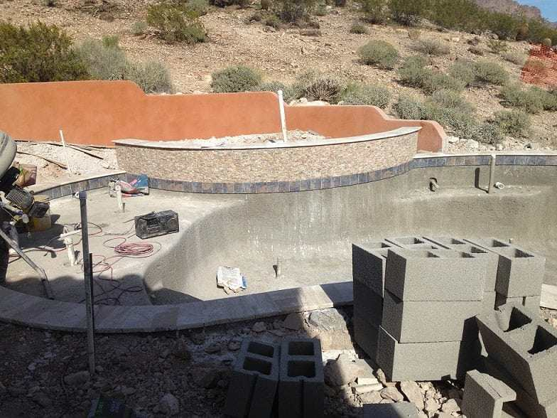 Installing tile around a new swimming pool in Dallas, Texas.