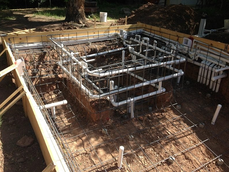 Close up, side view of swimming pool rebar and framework.