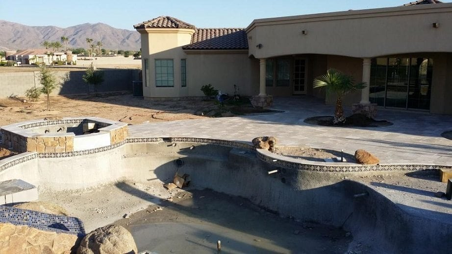 Beautiful pool patio and a view of a new swimming pool that has been built for the Young family in Tucson, Arizona.