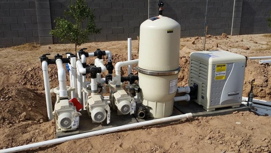 Front view of a swimming pool plumbing system and pipes.