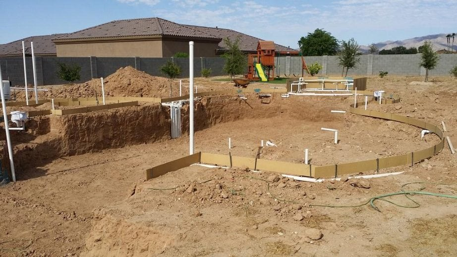 Close up view of a backyard in Phoenix, Arizona that had the swimming pool plumbing system installed.