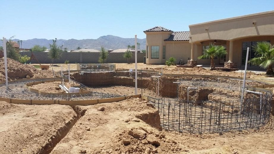 Zoomed out view of a pool that is being built. The pool rebar has been added, along with the pool electrical system.