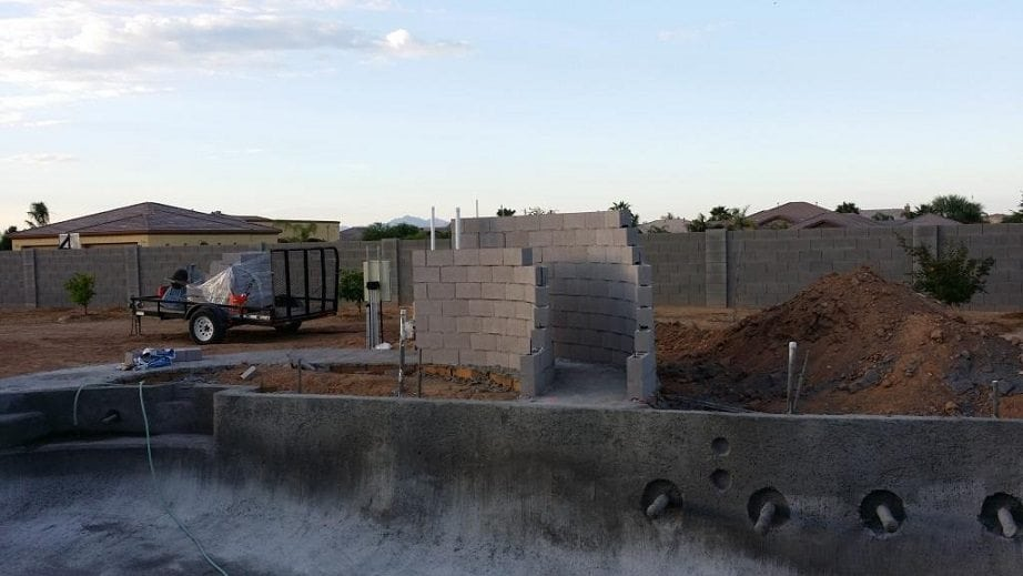 Construction underway for a water feature being added into a swimming pool that is being built in Tucson, Arizona.