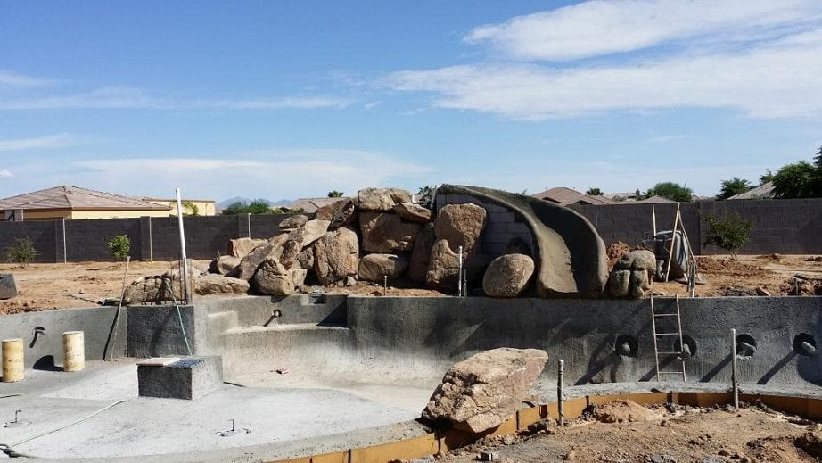 A swimming pool and waterfall that are being built for the Smith family in Texas.